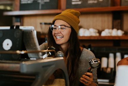 Why Hospitality Jobs Rock (and Why Ottawa County is the Best Place to Find Them!) girl barista female barista hipster barista yellow beanie waitress coffee shop cafe photo