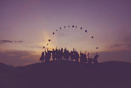 graduating kids throwing hats